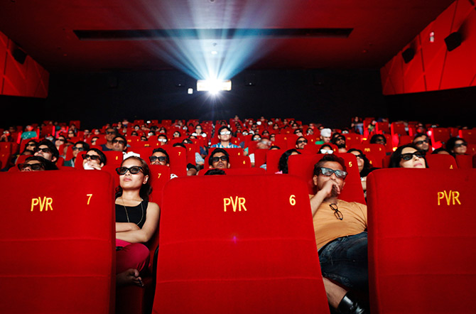 Cinema-goers wearing 3D glasses watch a movie at a PVR Multiplex in Mumbai November 10, 2013. Photo: Danish Siddiqui/Reuters