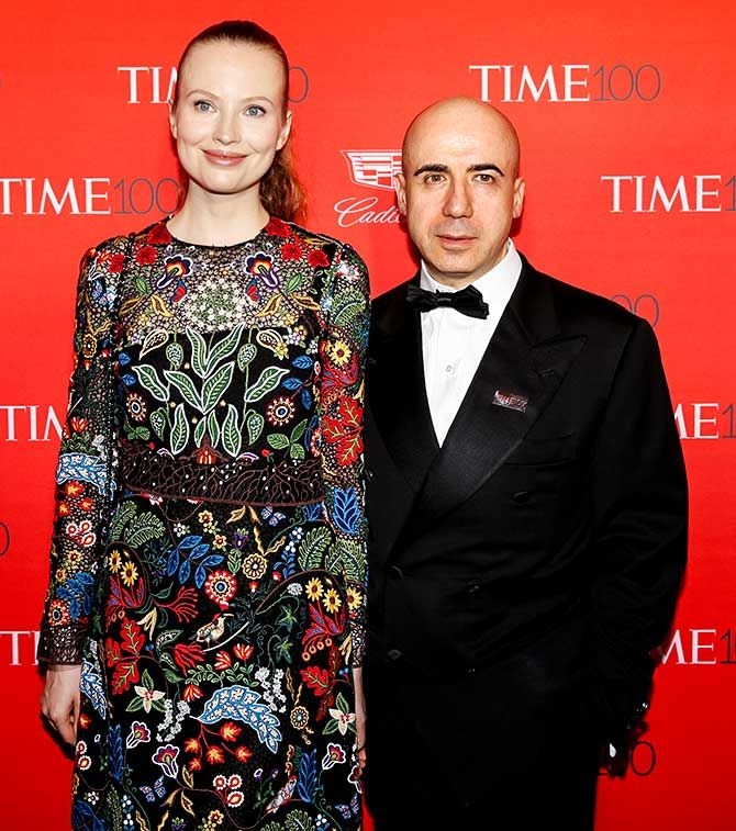 Yuri Milner, founder of DST Global, poses with an unidentified woman friend on the red carpet as they arrive for the TIME 100 Gala in Manhattan, New York, April 26, 2016. Photo: Shannon Stapleton/Reuters