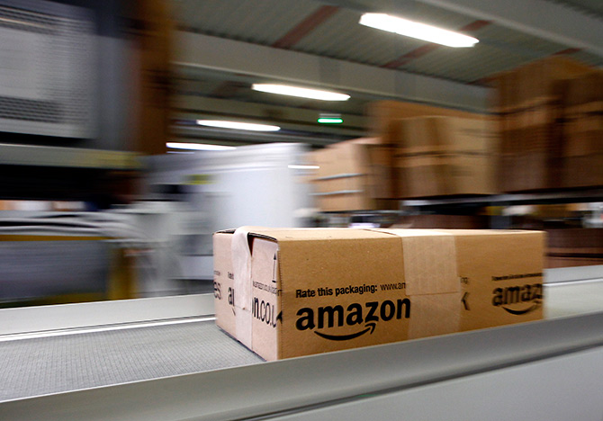 A parcel moves on the conveyor belt at Amazon's logistics centre in Graben near Augsburg, Germany. Photograph: Michaela Rehle/Reuters.