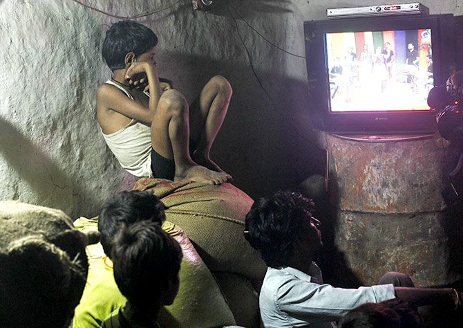 Children watch television powered by solar energy at Meerwada village of Guna district in the central Indian state of Madhya Pradesh June 18, 2012. Photograph: Adnan Abidi/Reuters