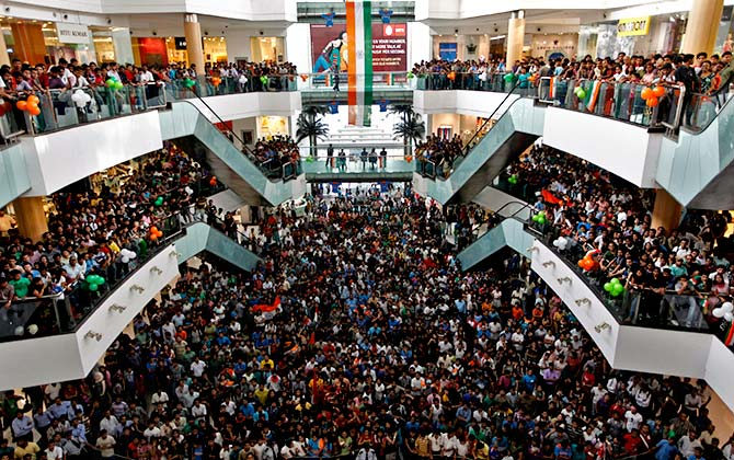 Cricket fans watch the ICC Cricket World Cup final match between India and Sri Lanka, on a big screen inside a shopping mall in Kolkata. Photograph: Rupak De Chowdhuri/Reuters