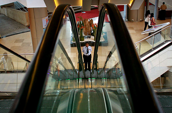 A security guard at a mall in Mumbai. Photograph: Danish Siddiqui/Reuters