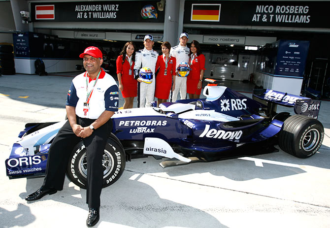Tony Fernandes, left, Group CEO of AirAsia, poses with Williams' Formula One drivers, Nico Rosberg of Germany and Alexander Wurz, second right, of Austria during a photocall in conjunction with the Malaysian F1 Grand Prix, Sepang, Malaysia. AirAsia is one of the new sponsors for Williams' Formula One team. Photograph: David Loh/Reuters.