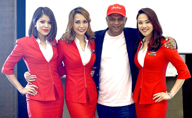 AirAsia's chief executive officer, Tony Fernandes poses for photos after a media conference near Changi Airport in Singapore. Photograph: Edgar Su/Reuters.