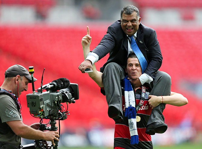 Queens Park Rangers Joey Barton and chairman Tony Fernandes celebrate after winning the Football League Championship Play Off final. Photograph: Action Images/Matthew Childs.