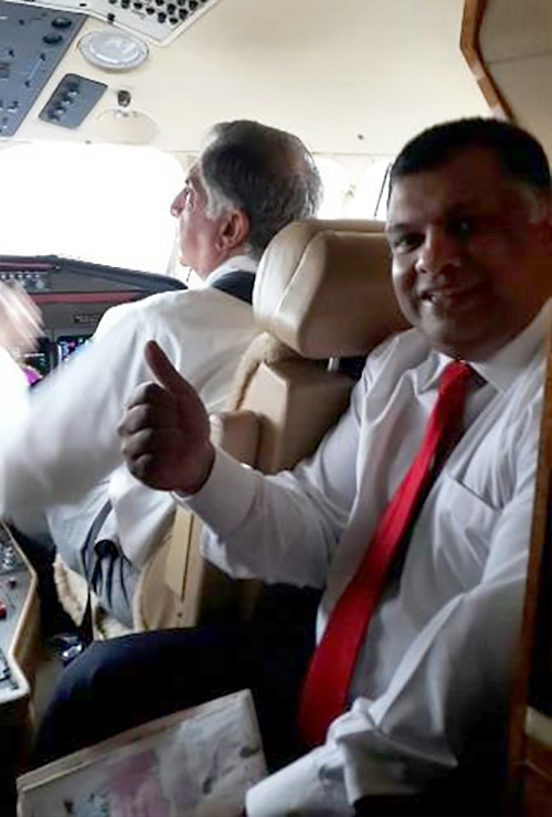 "AirAsia group CEO Tony Fernandes captioned this 2013 picture as: ""My new Pilot Sir Ratan Tata flying me to Delhi. Another way airasia cuts costs. The advisor is a pilot."" Photograph: Courtesy @tonyfernandes/Twitter."