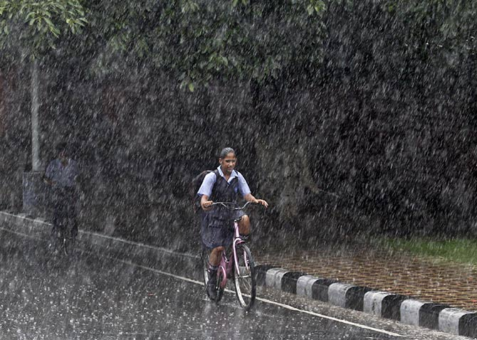 A schoolgirl rides home in Chandigarh. Photograph: Ajay Verma/Reuters.
