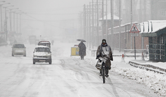 Braving the weather in Srinagar, Kashmir, Photograph: Danish Ismail/Reuters.