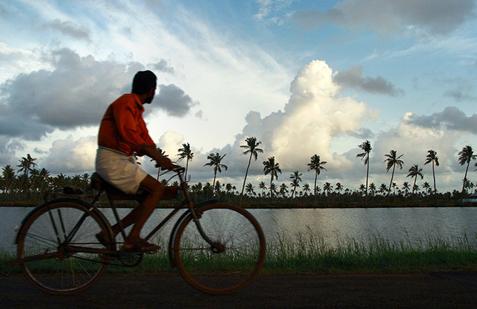 The monsonn, a bicycle and Kochi, Kerala. Photograph: Sivaram V/Reuters.