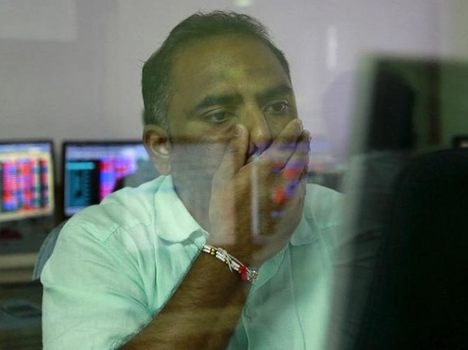 Sensex sinks 587 points; Yes Bank nosedives 14%