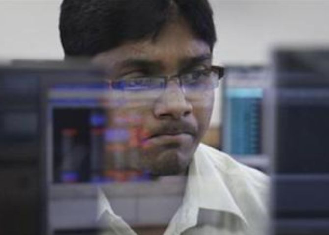 Markets off record highs; Sensex slumps 383 points