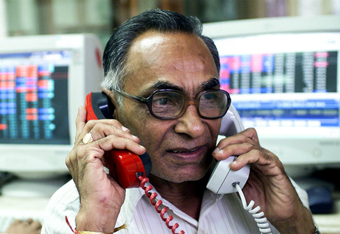 A stock broker trades in Bombay, India's financial capital. Photograph: Savita Kirloskar/Reuters.