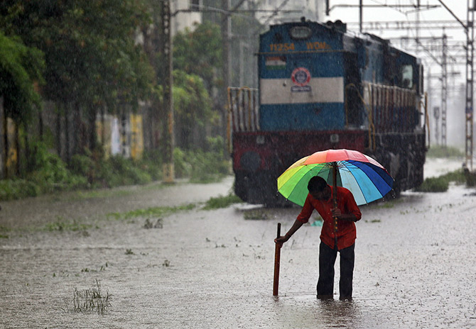 A keyman or gangman's work is much tougher in the monsoons, especially in the Mumbai area. Photograph: Francis Mascarenhas/Reuters.