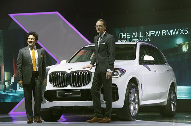 Sachin Tendulkar and Dr. Hans-Christian Baertels, President, BMW Group India with the BMW X5