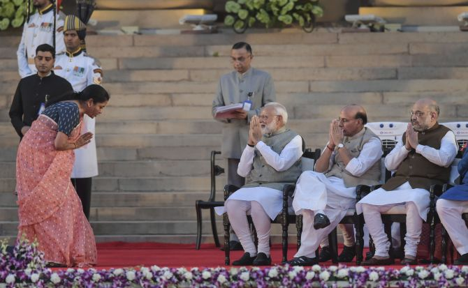Nirmala Sitharaman exchanges greetings with Prime Minister Narendra Modi after taking oath as a Cabinet minister