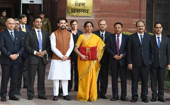 Finance Minister Nirmala Sitharaman, flanked by the minister of state for finance, chief economic adviser and other finance ministry officials, leaves the finance ministry for Parliament, February 1, 2020. Photograph: Press Information Bureau