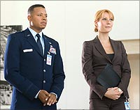 Terrence Howard and Gwyneth Paltrow in Iron Man