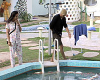 Poonam and Vindu appear shocked to see food floating in the pool