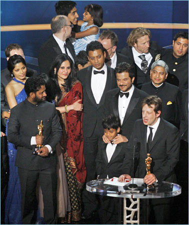 Ambassador Vikas Swarup, standing behind Anil Kapoor, as Slumdog Millionaire wins the Oscar for Best Picture