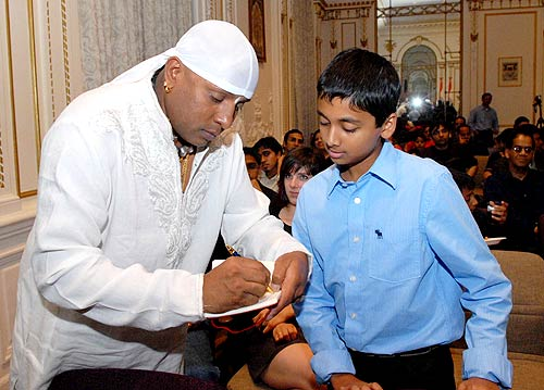 Sivamani signs an autograph for his young fan