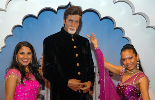 Dancers flank the waz figure of Amitabh Bachchan