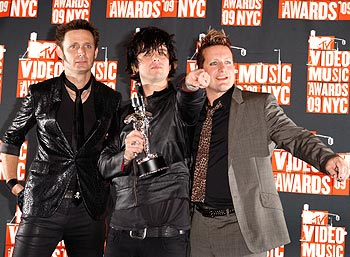 Members of Green Day pose with their award