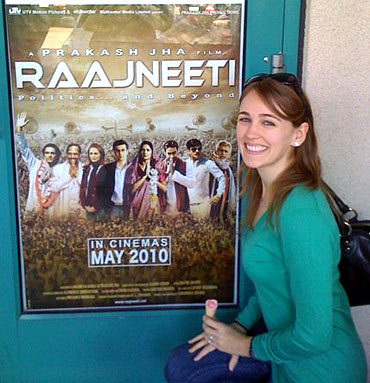 Sarah Thompson with a poster of Raajneeti in the US