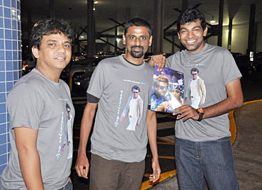 Fans display a poster of Endhiran