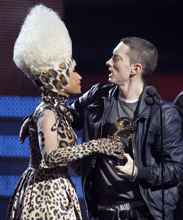 Presenter Nicki Minaj gives Eminem his award for Best Rap Solo Performance for Not Afraid