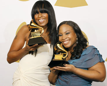 Songwriters Angela Hunte and Jane't Jnay Sewell-Ulepic pose with their awards for Best Rap Song for Empire State Of Mind