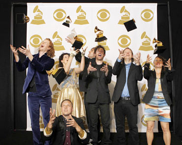 Rock group Arcade Fire throws their Album of the Year awards in the air for The Suburbs