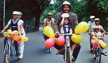 Anil Kapoor rides with Tina, and the other children