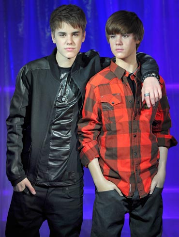 Justin Beiber with the waxwork model