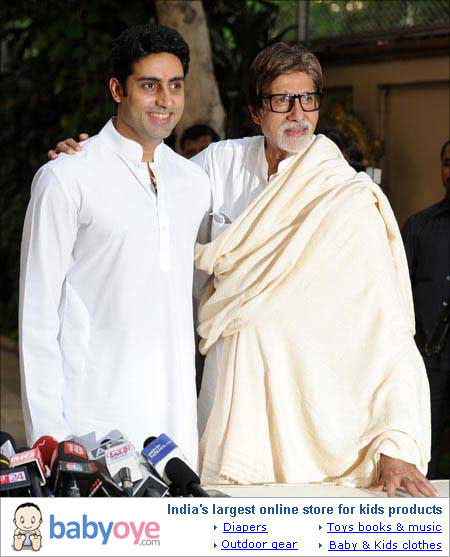 Amitabh and Abhishek Bachchan pose for the media