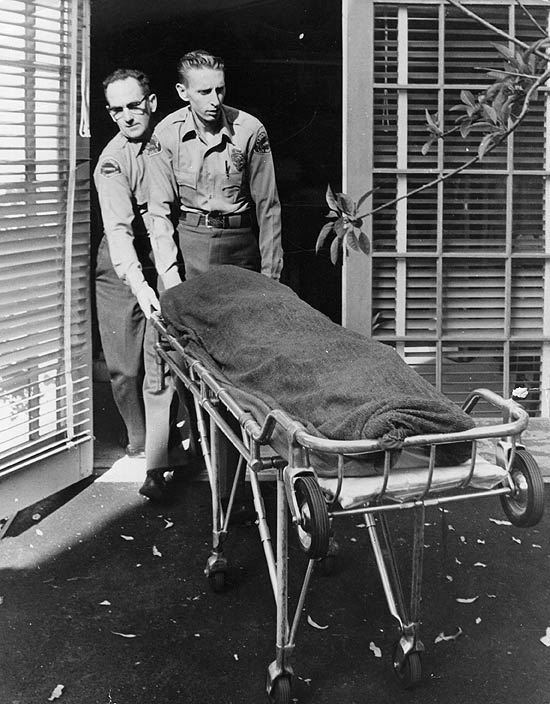 Monroe's body is wheeled out of her apartment