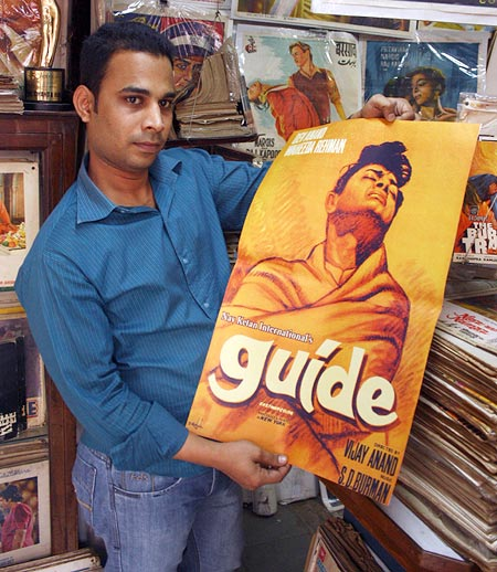 Haji Abu with the poster for Guide