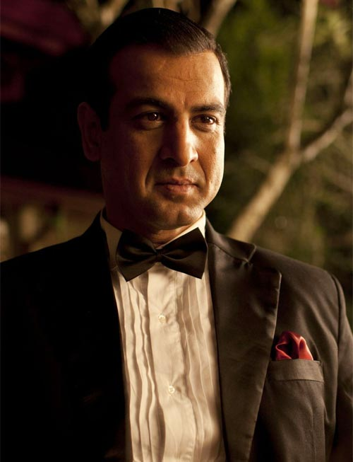 Ronit Roy as Ahmed Sinai