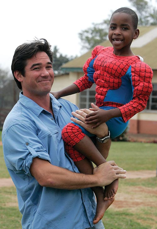 Actor Dean Cain holds a child