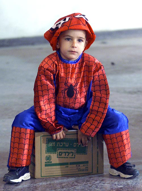 An Israeli boy in a spider-man costume