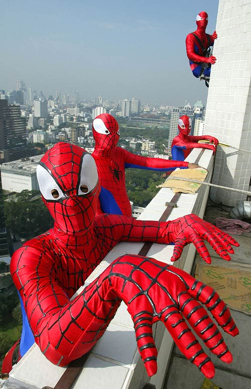 Men dressed in Spider-Man outfits