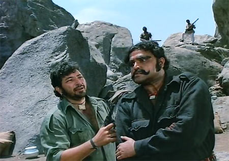 Amjad Khan and Viju Khote in Sholay.