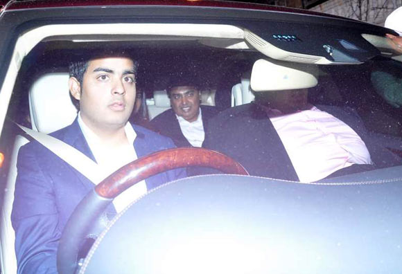 Mukesh Ambani (in the back seat) with kids