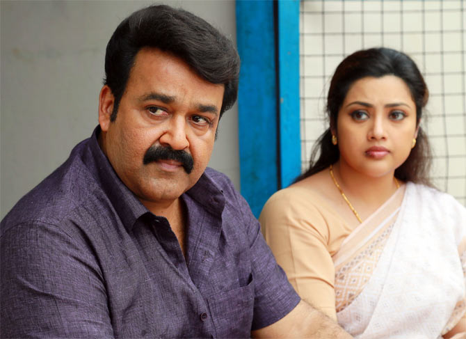 Mohanlal and Meena in Drishyam