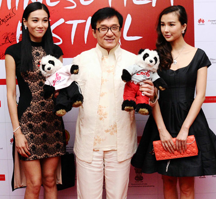 Jackie Chan with Chinese actresses Yao Xingtong (right) and Zhang Mengyu