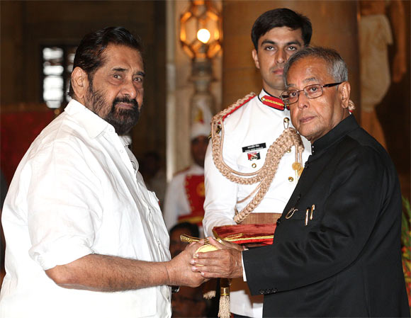 Madhu receiving the Padmashree award from President Pranab Mukherjee