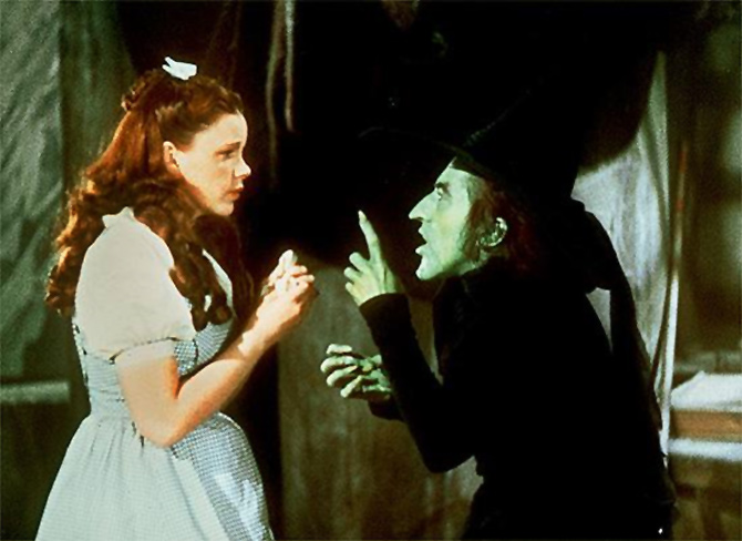 Judy Garland and Margaret Hamilton in Wizard of Oz
