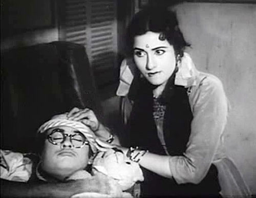 Kishore Kumar and Madhubala in Half Ticket