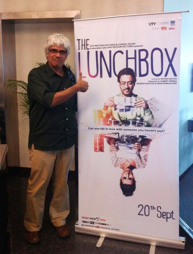 Director of The Good Road Gyan Correa with the poster of The Lunchbox
