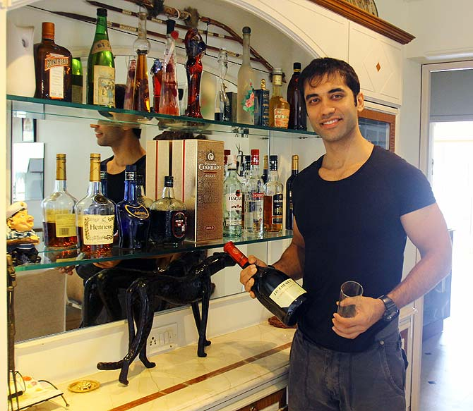 Kushal Punjabi poses next to his bar