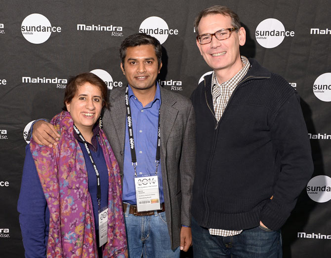 From left, filmmakers Guneet Monga, Neeraj Ghaywan and a guest attend the Sundance Institute Mahindra Global Filmmaking Award Reception.